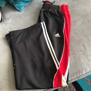 Red black and white adidas pants